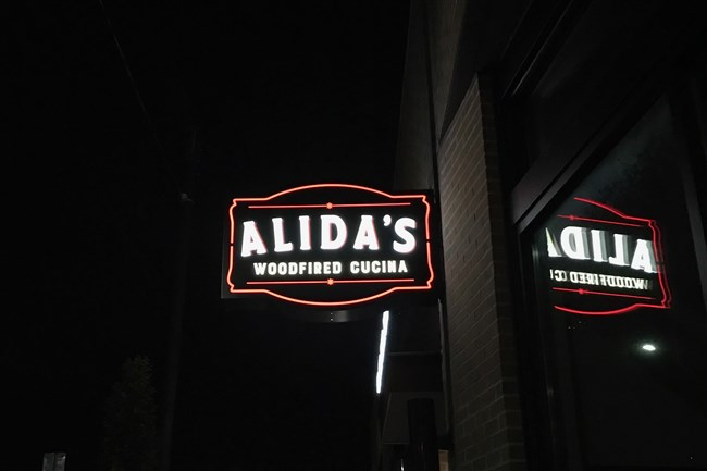 Alida's Woodfired Cucina opens with a full menu and lunch and dinner hours Nov. 24.