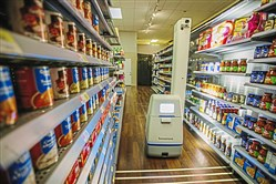 In this November 2017 photo, a robot made by Bossa Nova Robotics checks inventory in a mockup Walmart aisle at the company's test lab in the Strip District.