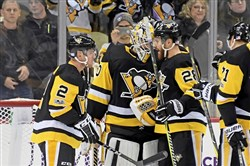 Chad Ruhwedel and Ian Cole congratulate Matt Murray after a recent win.