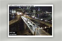 Traffic backs up on the Fort Pitt Bridge while crews put out a car fire on the upper deck on Tuesday.