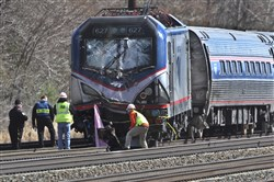 In this April 3 2016, file photo, Amtrak investigators inspect the deadly train crash in Chester, Pa. The Amtrak train struck a piece of construction equipment just south of Philadelphia causing a derailment.