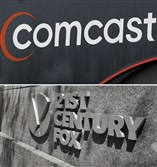 This combo of file photos shows the 21st Century Fox sign outside of the News Corporation headquarters building on Aug. 1, 2017, in New York, bottom, and a Comcast sign on Oct. 12, 2017, in Hialeah, Fla.