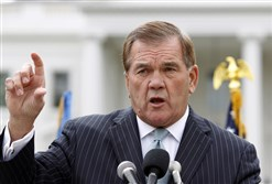 In this Oct. 22, 2011, file photo, former Secretary of Homeland Security and Pa. Gov. Tom Ridge speaks to a crowd of hundreds protesting in front of the White House in Washington.