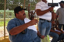 Dominican scouting director Rene Gayo, left, at work.