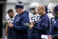 Penn State offensive coordinator Joe Moorhead, left, and coach James Franklin check notes during Wednesday's practice.