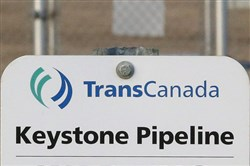 This Nov. 6, 2015, file photo shows a sign for TransCanada's Keystone pipeline facilities in Hardisty, Alberta.
