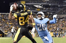 Receiver Antonio Brown pulls in a touchdown against the Tennessee Titans' Logan Ryan in the fourth quarter Thursday at Heinz Field.