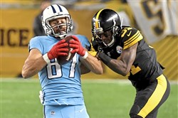 Mike Hilton stops Titans WR Eric Decker after a reception in the first quarter Thursday.