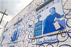 A mural by Bob Ziller covers the rear of a building at 800 Penn Ave. in Wilkinsburg. It was sponsored by the Center for Civic Arts as part of efforts to revitalize the borough.