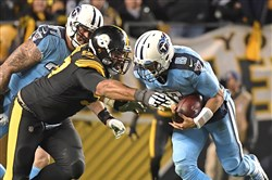 Cameron Heyward sacks Titans QB Marcus Mariota pn Thursday night at Heinz Field.
