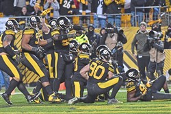 Steelers defensive players pose for a fake photo after an interception against the Titans in the fourth quarter at Heinz Field Thursday.