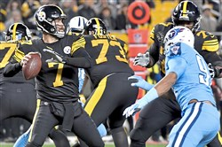 Steelers quarterback Ben Roethlisberger drops back to pass against the Titans in the first quarter at Heinz Field Thursday. He threw four touchdown passes in the game.