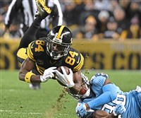 The Steelers' Antonio Brown makes a catch against the Titans Thursday night at Heinz Field.