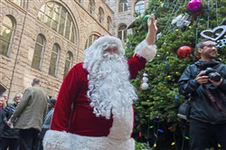 Santa greets participants during the Light Up Night celebrations on Friday at the Allegheny County Courthouse, Downtown.