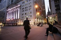 A man walks to work on Wall Street, near the New York Stock Exchange.
