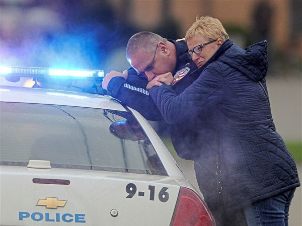 New Kensington Police Chief James Klein and Lisa Shaw, mother of slain New Kensington Patrolman Brian Shaw share a moment while waiting at the Rusiewicz Funeral Home in Lower Burrell for the procession to arrive Saturday, November 18, 2017. (Pam Panchak/Post-Gazette)
