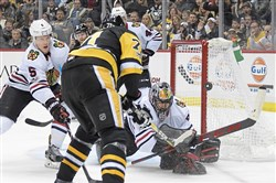 Blackhawks Corey Crawford makes save on Penguins Evgeni Malkin Saturday, November 18, 2017, at PPG Paints Arena in Pittsburgh.