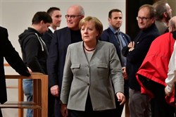 German Chancellor and leader of the Christian Democratic Union party Angela Merkel (C) is seen during a break in exploratory talks with members of potential coalition parties to form a new government November 19, 2017 in Berlin.