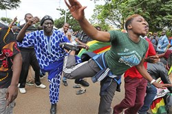 Euphoric crowds march and dance in Harare, Zimbabwe, on Saturday, demanding the departure of President Robert Mugabe. The military, which put Mr. Mugabe under house arrest, approved the demonstration that included people from across the political spectrum.