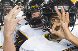 "Thomas Jefferson's DeRon VanBibber holds up three fingers to signify a ""three-peat"" victory of the WPIAL Class 4A championship last Saturday."