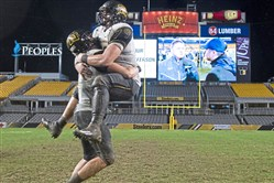Thomas Jefferson's Noah Palmer, right, celebrates with Devin Danielson after winning the WPIAL Class 4A championship Saturday. Thomas Jefferson will play Erie Cathedral Prep in the PIAA playoffs Friday.