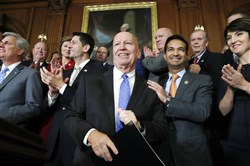 House Ways and Means Chair Rep. Kevin Brady, R-Texas, center, is welcomed by House Republicans including from left, House Majority Leader Kevin McCarthy of Calif., House Speaker Paul Ryan of Wis., Rep. Carlos Curbelo, R-Fla., and Rep. Cathy McMorris Rodgers, R-Wash., as they arrive to speak to the media following a vote on the GOP tax bill, Thursday, Nov. 16, 2017, on Capitol Hill in Washington.