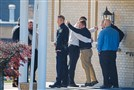 Mourners comfort each other after paying their respects to New Kensington Police Officer Brian Shaw during a visitation service Monday at Rusiewicz Funeral Home in Lower Burrell.