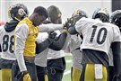 The Steelers receiving core huddles up during practice Monday.