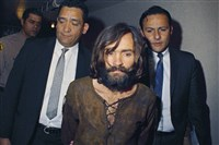 1969: Charles Manson is escorted to his arraignment on conspiracy-murder charges in connection with the Sharon Tate murder case.