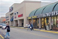In this 2004 photo, people shop at Miracle Mile shopping center off of Business Route 22 in Monroeville.