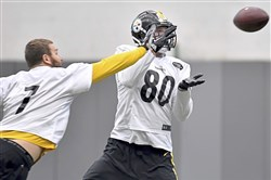 Ben Roethlisberger plays a little defense on practice squad tight end Jake McGee during practice at UPMC Rooney Sports Complex Monday, November 20, 2017 on the South Side. (Matt Freed/Post-Gazette)