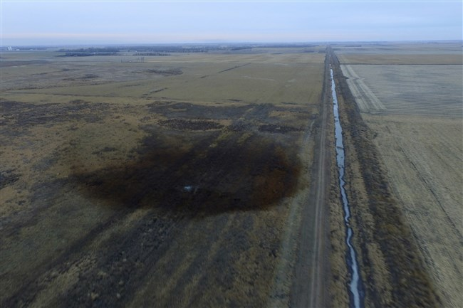 This aerial photo shows spills from TransCanada Corp.'s Keystone pipeline Nov. 17, 2017, that leaked an estimated 210,000 gallons of oil onto agricultural land in northeastern South Dakota, near Amherst, S.D., the company and state regulators said Thursday, but state officials don't believe the leak polluted any surface water bodies or drinking water systems.