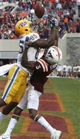 Virginia Tech defender Greg Stroman breaks up a pass in the end zone intended for Pittsburgh wide receiver Jester Weah in the final minute of an NCAA college football game in Blacksburg, Va., Saturday.