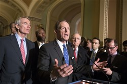 Sen. Pat Toomey, R-Pa., center, joined by, from left, Sen. Rob Portman, R-Ohio, Sen. Tim Scott, R-S.C., and Senate Majority Leader Mitch McConnell, R-Ky., talks about the Senate Finance Committee's work on overhauling the nation's tax code, on Capitol Hill in Washington, Tuesday, Nov. 14, 2017.
