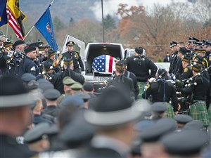 The hearse arrives for the funeral service for New Kensington Officer Brian Shaw Wednesday, Nov. 22, 2017, at Mount Saint Peter Church in New Kensington. Officer Shaw was killed in the line of duty Friday evening after making a traffic stop.