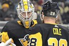 Matt Murray and Ian Cole chat during Wednesday's loss to the Canucks. (Peter Diana/Post-Gazette)
