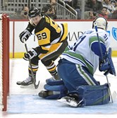 Jake Guentzel beats Vancouver goaltender Anders Nilsson in the first period Wednesday.