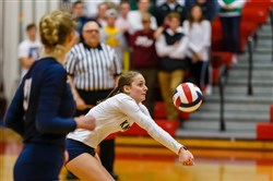 Knoch's Carly Bozzo, a senior libero, records a dig.