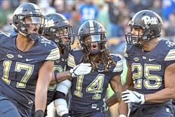 Pitt's Rashad Weaver, Saleem Brightwell, Avonte Maddox and Elijah Zeise celebrate a sack against Miami on Friday.