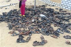 Discarded shoes of victims remain outside Al-Rawda Mosque in Bir al-Abd northern Sinai, Egypt. a day after attackers killed hundreds of worshippers.