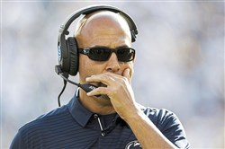 Penn State head football coach James Franklin talks to his coaches during an NCAA college football game against Pittsburgh, Saturday, Sept. 9, 2017 at Beaver Stadium in State College, Pa.