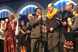 "Front Porch co-producer Leon Zionts (center, with microphone) introduces the directors of the company's 2018 shows: Robyne Parrish (left, red dress) takes on ""Grey Gardens,"" and Connor McCanlus (right, yellow scarf) will helm ""A New Brain."" The announcement came at a musical fundraiser at the Cabaret at Theater Square Monday."