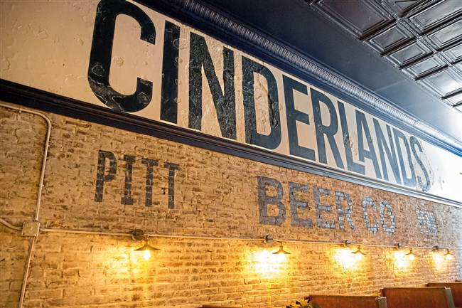 Finishing repairs are made before the opening of Cinderlands Beer Co. on Tuesday, Nov. 28, 2017 in Lawrenceville.