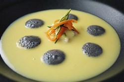 "Vellutata di Patate con Baccala al Nero di Seppia (Creamed Saffron Potato Soup with Baccala and Squid Ink Foam served with Julienne Vegetables), one of the ""seven fishes"" to be served on Christmas Eve at Senti in Lawrenceville."