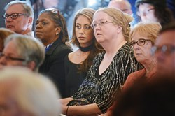 "Natalie Romano and her mother, Joanne Romano of Monongahela, listen to Pennsylvania Attorney General Josh Shapiro answer questions during a substance abuse forum titled ""Challenges to Recover"" at St. Paul's Episcopal Church in Mt. Lebanon on Wednesday. The Romanos say they nearly lost a family member to an opioid overdose."