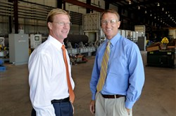 In this file photo, Frank Perryman, president and CEO, and his brother, COO Jim Perryman Jr., of Perryman Co. in the rolling section of their titanium plant in Houston, Washington County.