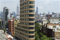 This file photo shows a view of 10 Sullivan Street from southwest, across Sixth Avenue of what was originally the 45-million-dollar triplex penthouse, and is now a duplex, in New York, July 7, 2016.