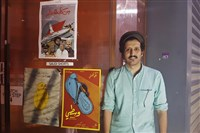 "In this Aug. 25, 2017, file photo, Saudi filmmaker Ali Kalthami stands next to the poster for his film ""Wasati,"" or ""Moderate,"" and two other Saudi short films recently shown at Cinema Akil in Dubai, United Arab Emirates."
