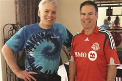 This Dec. 2, 2017, photo provided by Jay Konduros, left, shows him and his brother, Bill, at Jay's home in Cambridge, Ontario, Canada.