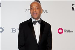 In this file picture taken February 26, 2017, entrepreneur and producer Russell Simmons poses upon his arrival for the 25th annual Elton John AIDS Foundation's Academy Awards Viewing Party in West Hollywood, California.